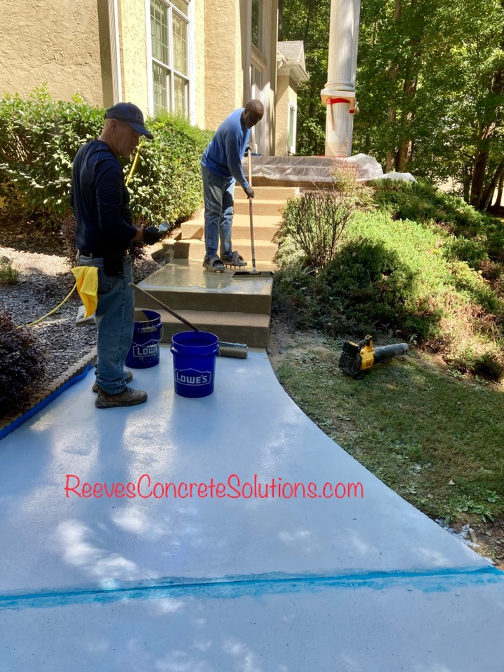 Roswell, GA - 2nd coat of Permaflex is being applied and first broadcast of quartz going down on this sidewalk and front stoop resurfacing project