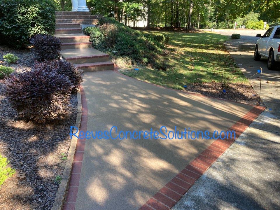 Alpharetta, GA - Finishing up this front stoop and sidewalk.  Concrete resurfaced using Graniflex Quartz