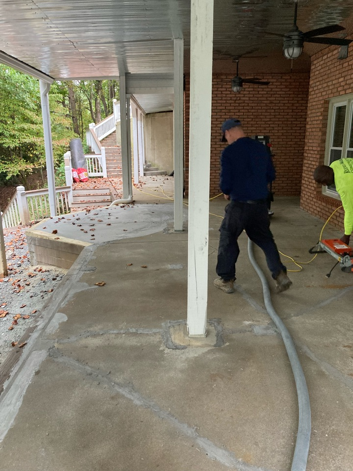 Woodstock, GA - Preparing to transform this back patio with a rustic concrete wood concrete coating