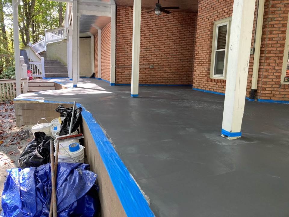 Woodstock, GA - Grout coat going down on this rustic concrete wood patio overlay