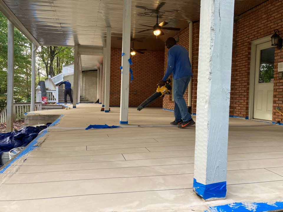 Woodstock, GA - The tape is pulled and we are making final preparations for stain on this rustic concrete wood patio