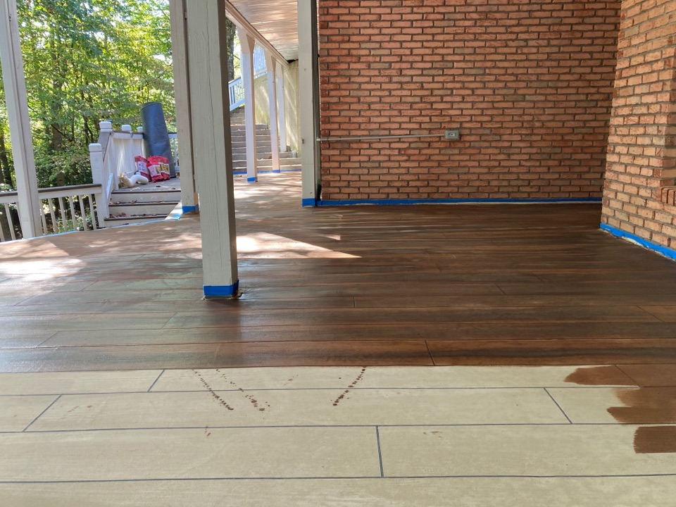 Woodstock, GA - First coat of stain going on this rustic concrete wood patio floor