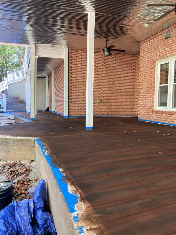 Woodstock, GA - Second coat of stain is on this rustic concrete wood patio.  Next step is sealer.