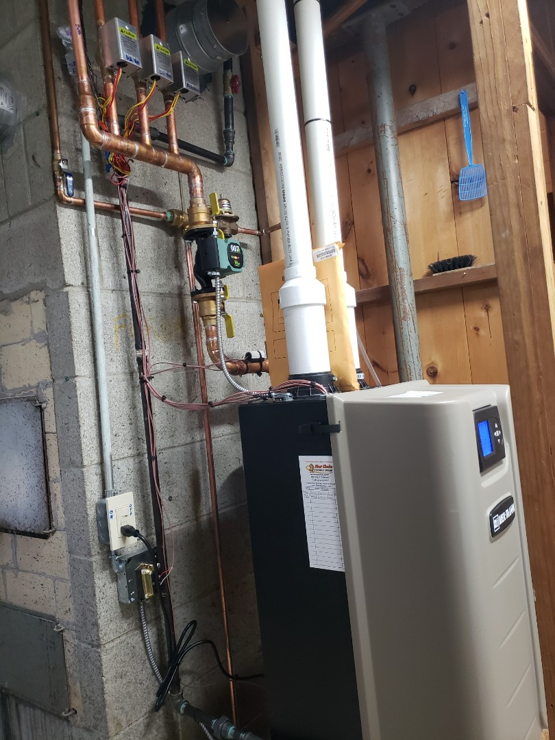 Linden, MI - Assisted install team putting in a new Weil Mclain Evergreen boiler.
