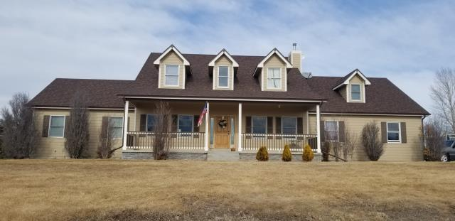 Severance, CO - Completed Project: Reroof of home using Owens Corning Duration Storm Asphalt Shingles, Replacement of 5 inch aluminum seamless gutters, garage door replacement, exterior painting, light fixture replacement, and rescreening of window screens