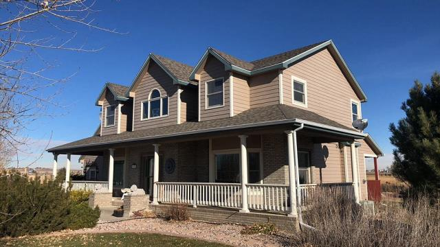Greeley, CO - Completed Project: Reroof of home using Owens Corning Duration Storm Asphalt Shingles and replacement of 5 inch aluminum seamless gutters