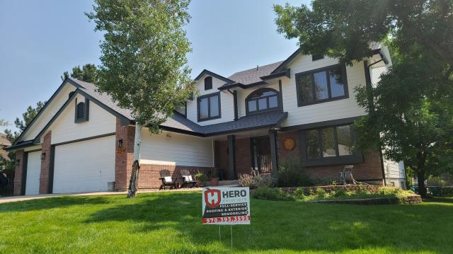 Fort Collins, CO - Replaced asphalt shingle with Atlas Storm Master Shake Class 4 impact resistant shingles, new seamless aluminum gutters and new exterior paint colors with Sherwin Williams Exterior Emerald Satin paint.