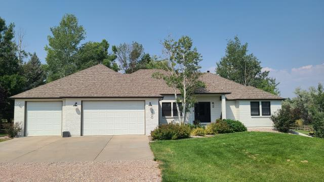 Fort Collins, CO - Exterior painting completed with Sherwin Williams Duration Satin exterior paint. Siding repaired with LP Smart Lap Siding. New seamless aluminum dark bronze gutters and downspouts.