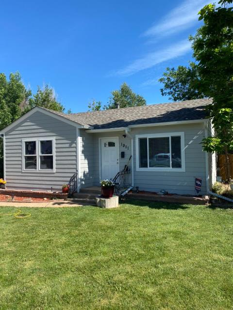 """Greeley, CO - Finished Project: Full siding replacement including house wrap, Reroof using Atlas Pinnacle Pristine shingles, masonry replacement of flower bed, Replacement of 5"""" galvanized aluminum seamless gutters and full house paint job using Sherwin Williams Resilience Exterior Satin paint"""