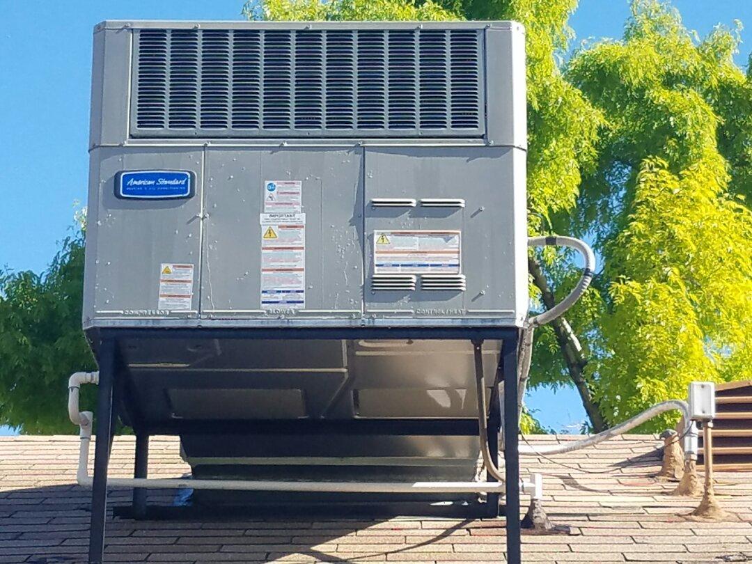 Sun City West, AZ - Cooling Maintenance for American Standard rooftop Packaged Heat Pump System