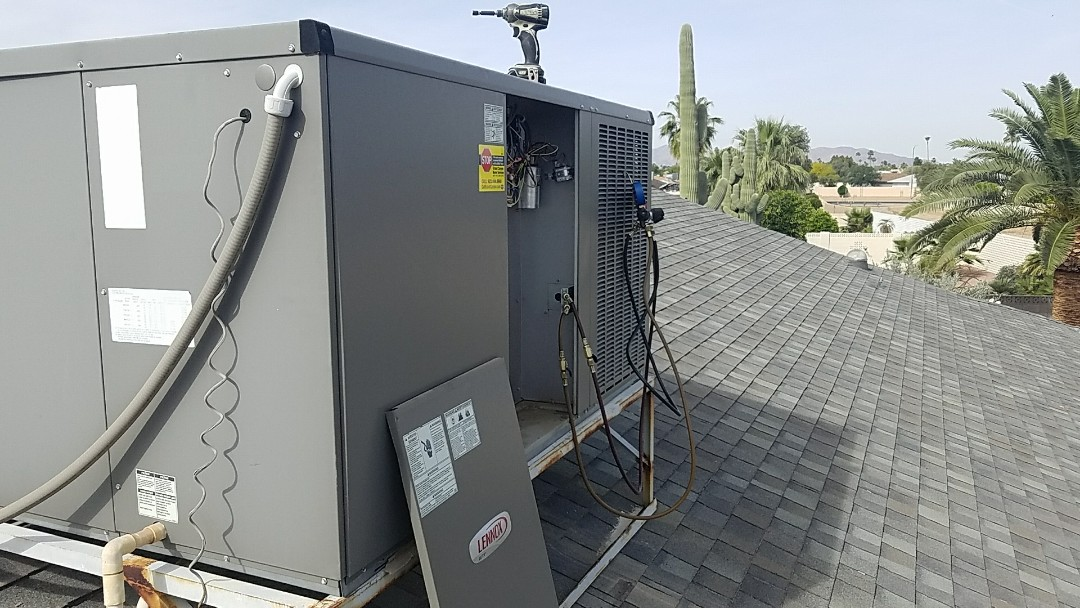 Surprise, AZ - Seasonal cooling maintenance on Lennox package heat pump system for Grand Canyon Home Services Care Club Member.