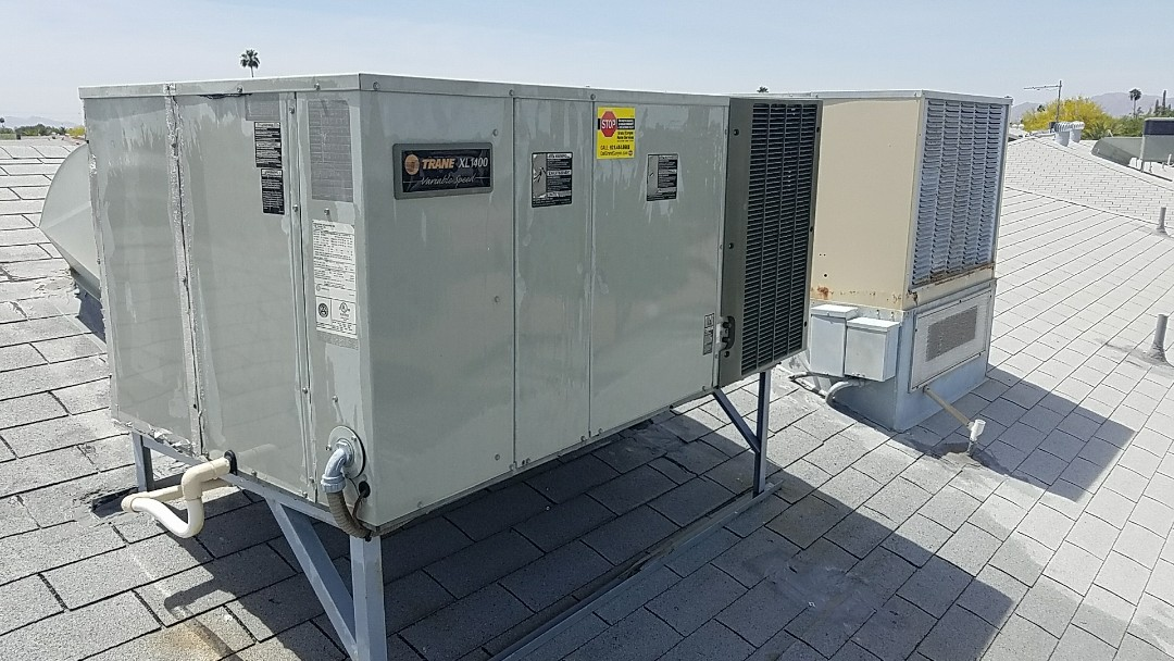 Sun City West, AZ - Seasonal cooling maintenance in replacement of voltage absorption system on Trane packaged heat pump system for Grand Canyon Home Services Care Club member.