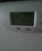 Surprise, AZ - Air conditioner maintenance on a package unit.