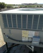 Sun City West, AZ - Checking all components in a package unit for seasonal maintenance.