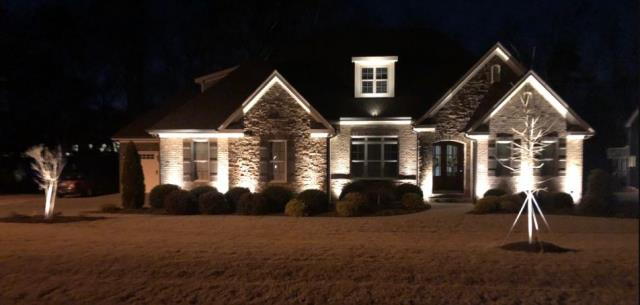 Benson, NC - New LED Up Lighting installation on front and back of house and trees, highlighting stone on front of house and porch area for the holidays.