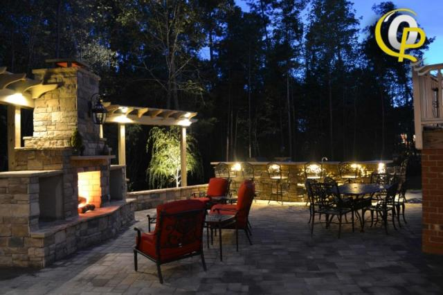 Southern Pines, NC - Install outdoor up lighting and path lighting service with LED lamps on residential home near Southern Pines Golf Club. The goal is to highlight backyard landscape wall.