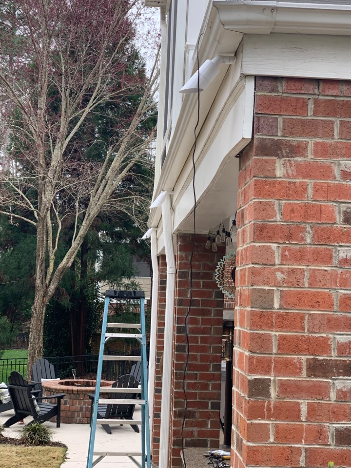 Cary, NC - Installing LED up lighting on trees and house, path lights on walkway and down lights on corn hole area
