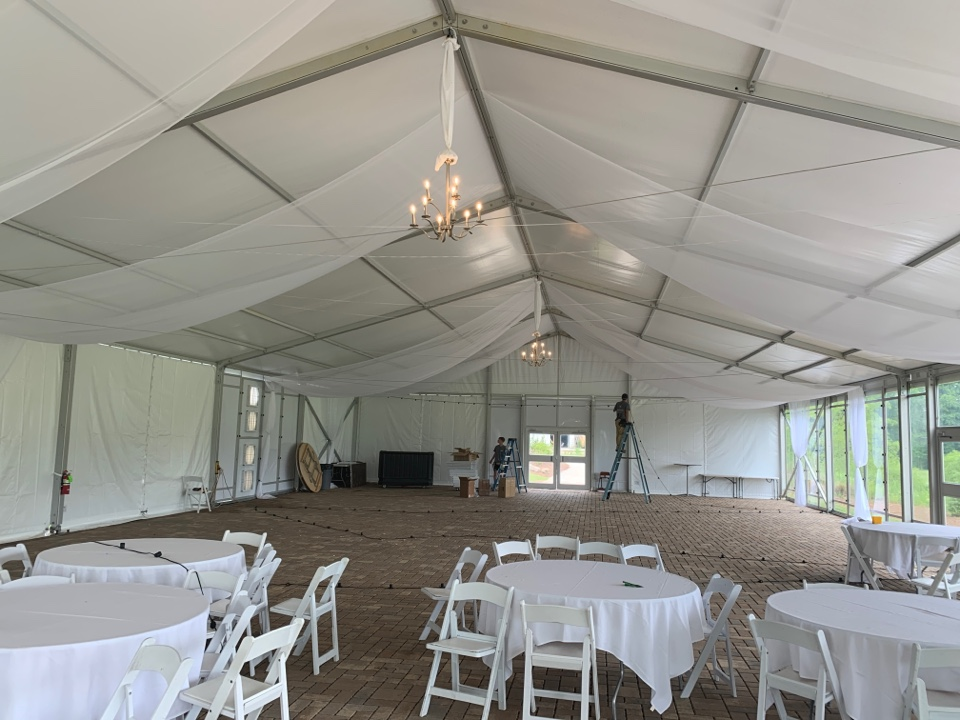 Holly Springs, NC - Installing Bistro Lighting with LED lamps in Wedding Tent