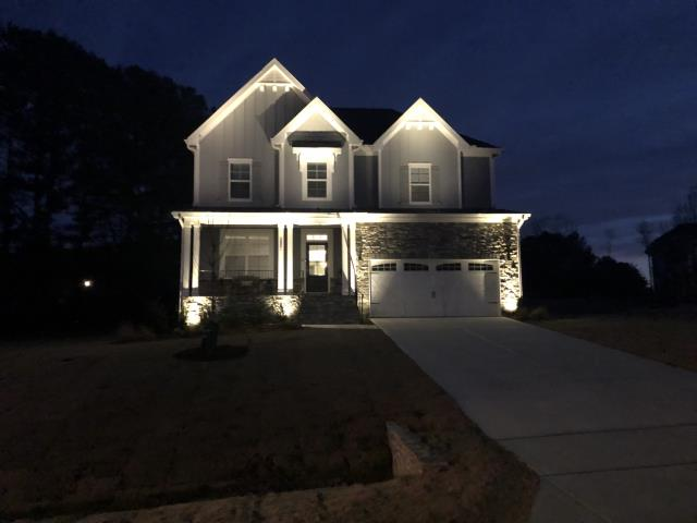 Fuquay Varina, NC - Final adjustments on uplighting front of house