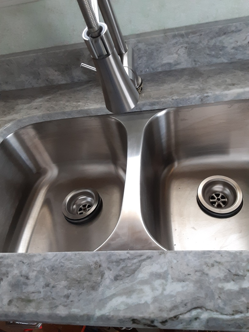 Saraland, AL - Plumbing services on kitchen sink Faucet and drain pipe in saarland Ala