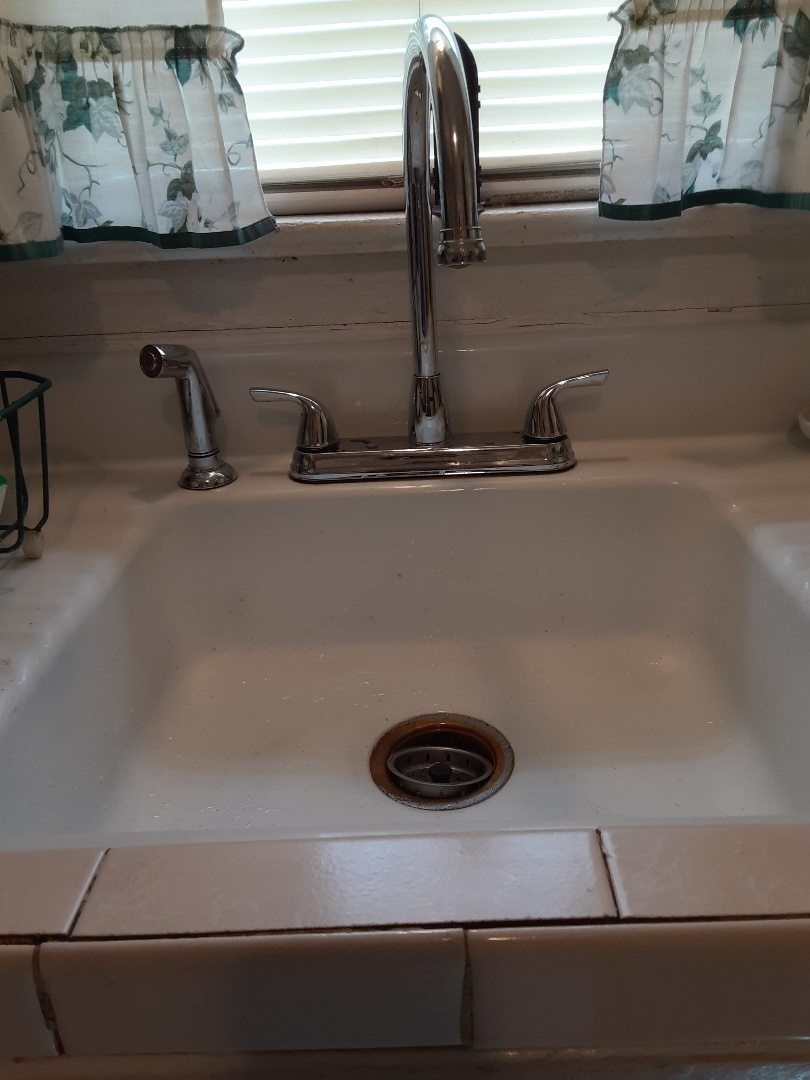 Plumbing services on kitchen sink Faucet in Mobile Ala