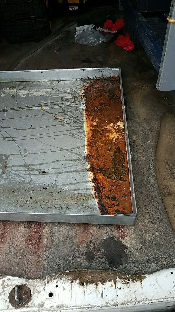 Argyle, TX - Replacing rusted air conditioner drain pan.