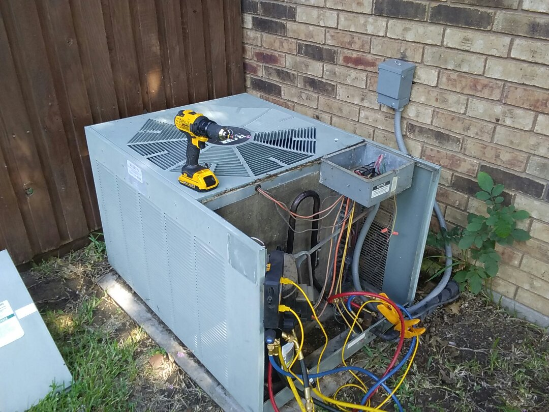 Lewisville, TX - Inspection on a Rheem air conditioner