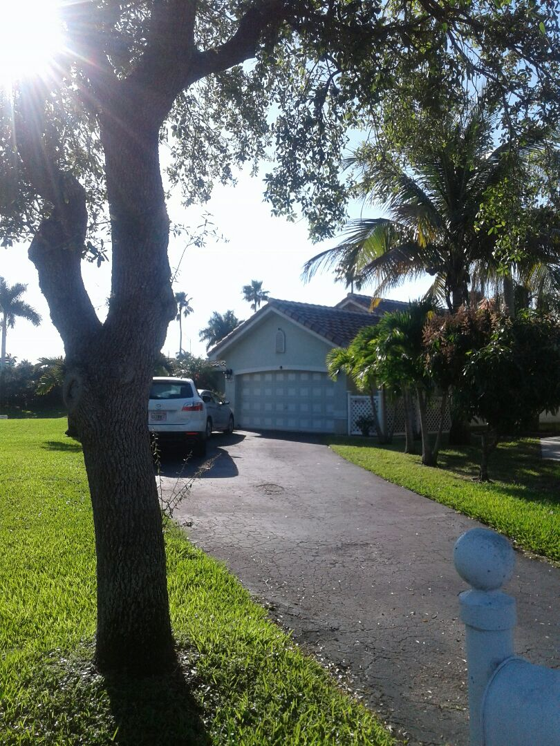 Davie, FL - Tile roof repair in the city of Davie Florida this repair is being done by Earl W Johnston roofing company Tony and Regis are you repair technicians