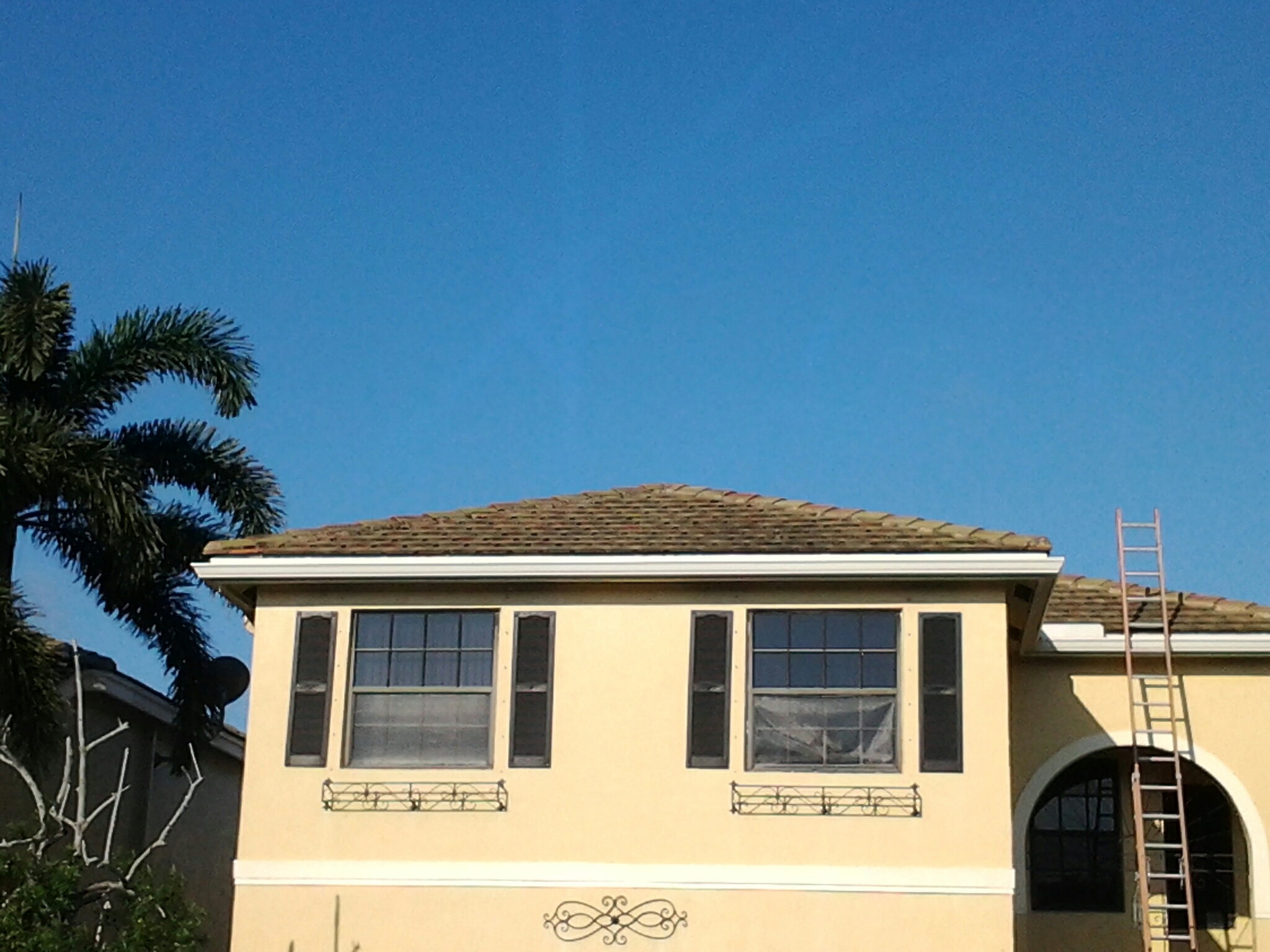 Coral Springs, FL - Pressure clean and roof a cide in Coral Springs by Duane & Gary from Earl W Johnston Roofing