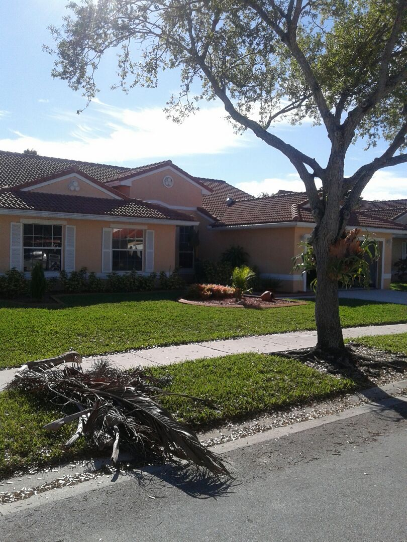Pembroke Pines, FL - Tile roof repair in the city of Pembroke Pines Florida this repairs being done by Earl W Johnston roofing company Tony and Regis audio repair technicians