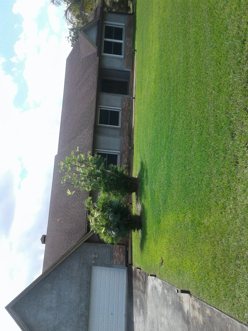 Davie, FL - Fascia board repair in the city of Davie Florida this repairs being done by Earl W Johnson roofing company. Glenn is in charge