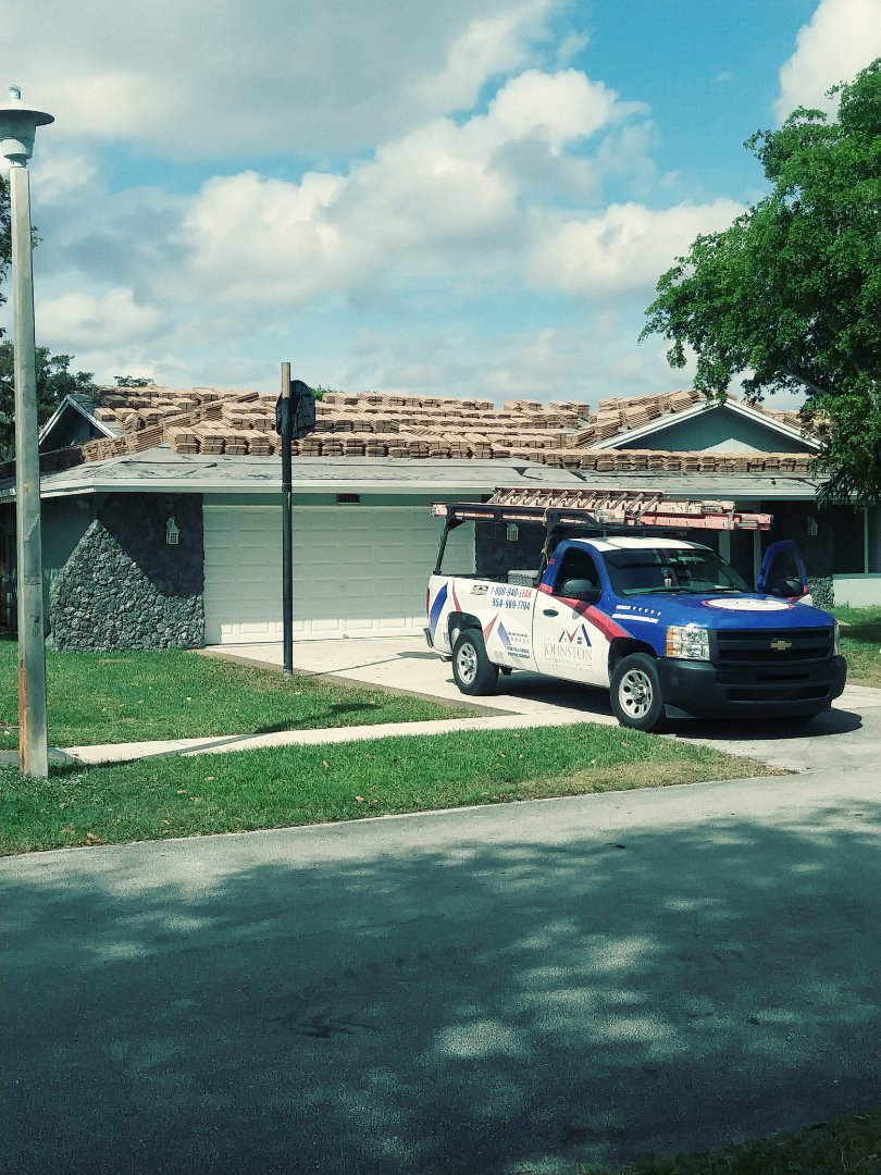 Plantation, FL - Eagle flat concrete roof tile loaded on the roof ready to be installed by earl w Johnston roofing llc