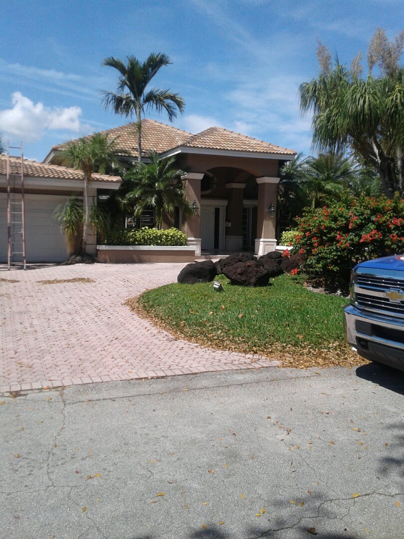 Pembroke Pines, FL - Tile roof repair and the City of Hollywood Florida this repairs being done by Earl W Johnston roofing company Tony and Regis are you repair technicians