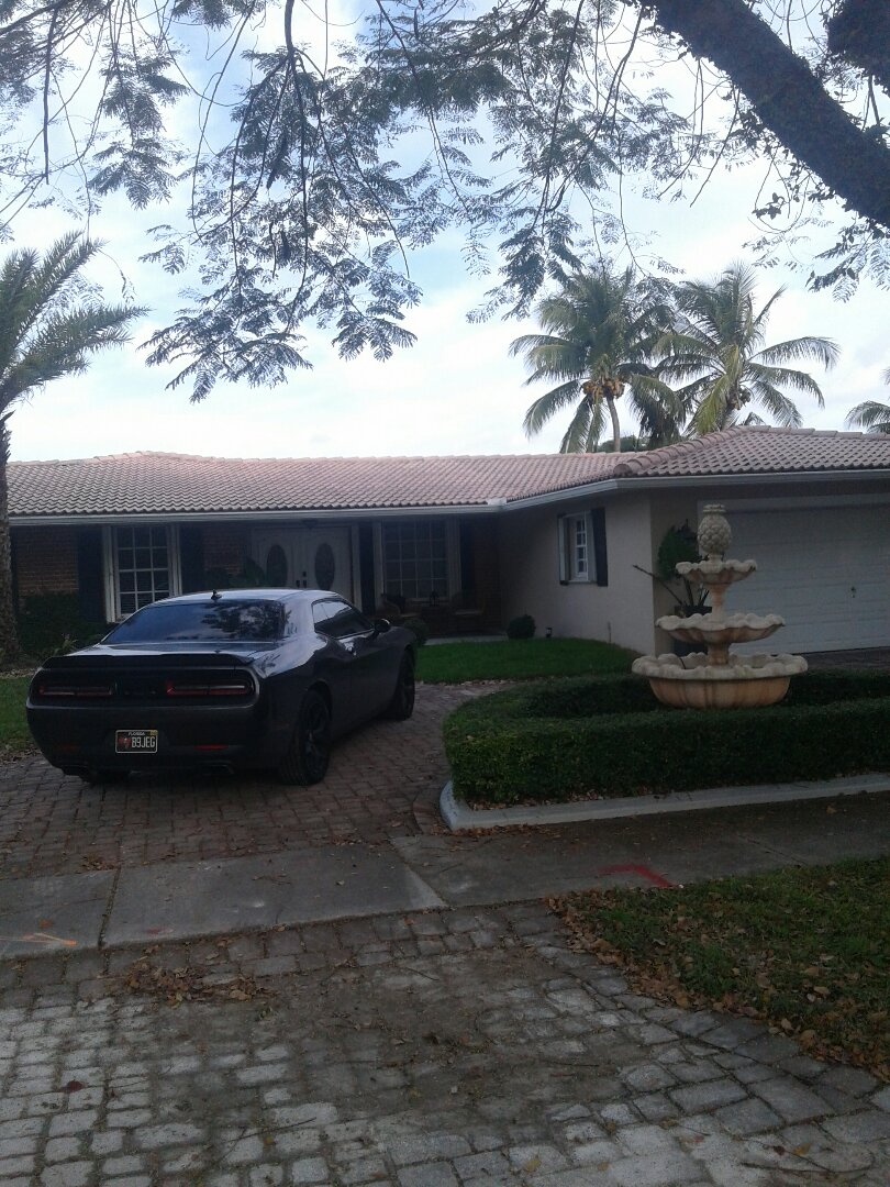 Miami Lakes, FL - Roof tile repair in the city of Miami Lakes Florida this repairs being done by Earl W Johnston roofing company Tony is your supervisor