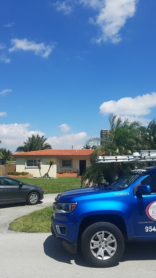 North Miami, FL - Tile and flat roof leak repair estimate by Aj from Earl Johnston Roofing Company