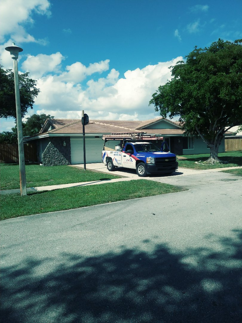 Plantation, FL - Finished eagle low profile concrete roof tile and gaf flat roof by earl w Johnston roofing llc