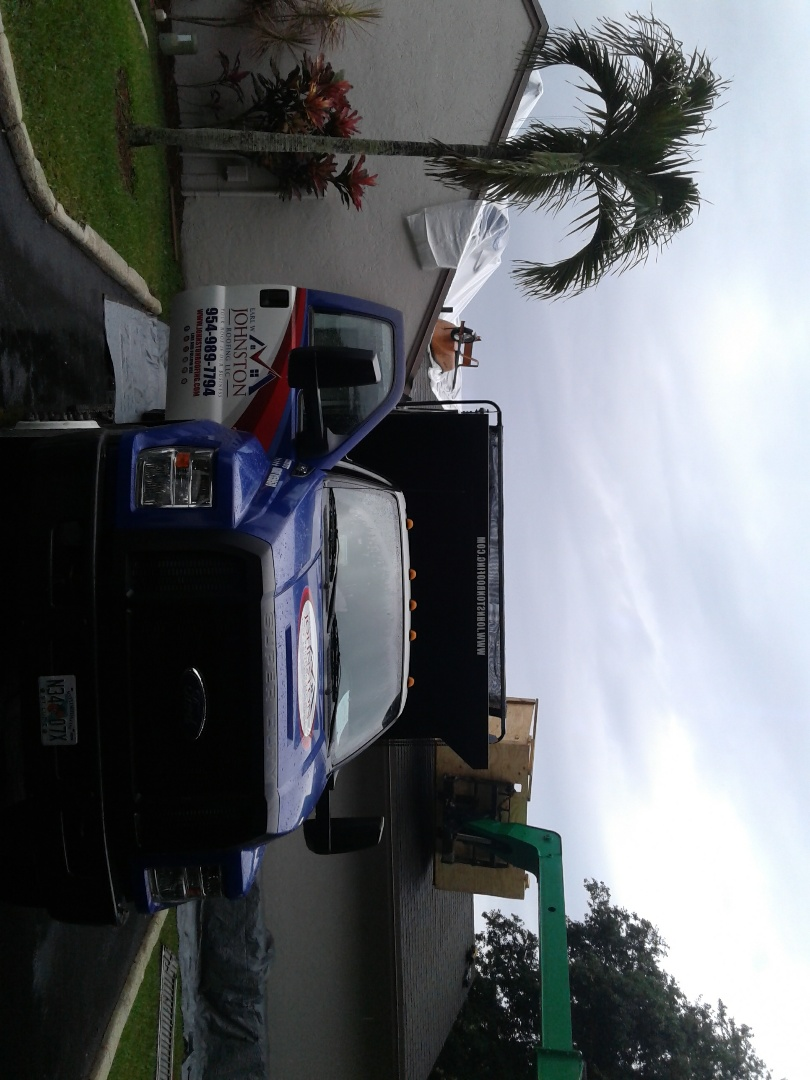 Plantation, FL - Starting a 128sq shingle reroof in plantation, by Earl w Johnston roofing.