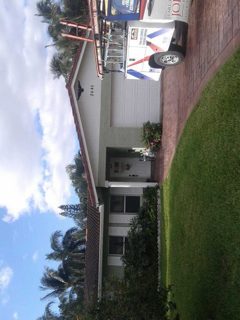 Pompano Beach, FL - Roof tile repair in the city of Pompano Beach Florida just repairs being done by Earl W Johnston roofing company Tony and Regis are you repair technicians