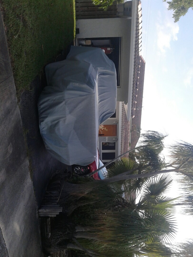 Hollywood, FL - Tile roof repair in the city of Hollywood Florida this repair is being done by Earl W Johnston roofing company Tony and Regis are your repair technicians
