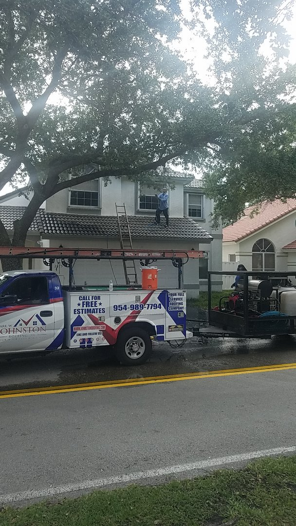 Margate, FL - Tile roof cleaning and roof-a-cide treatment by Earl Johnston Roofing Company.  Your full service Roofing Company