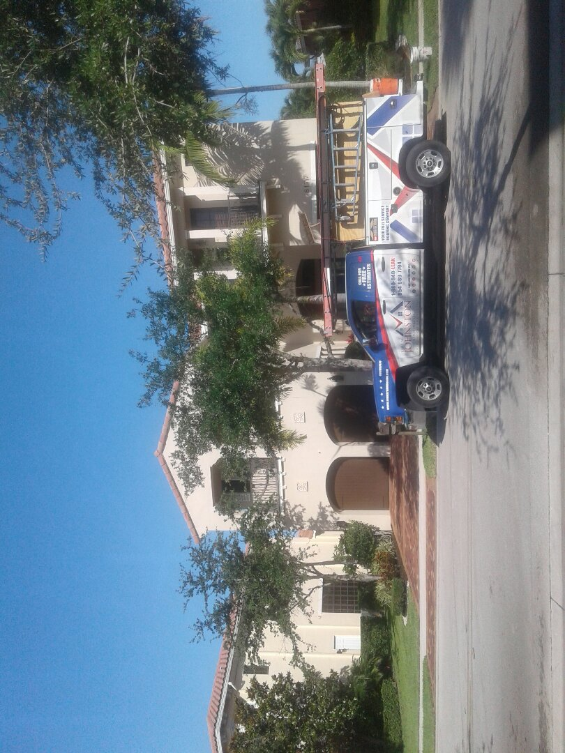 Tile roof repair in the city of Parkland Florida just repairs being done by Earl W Johnson roofing company Tony and Regis are you repair technicians