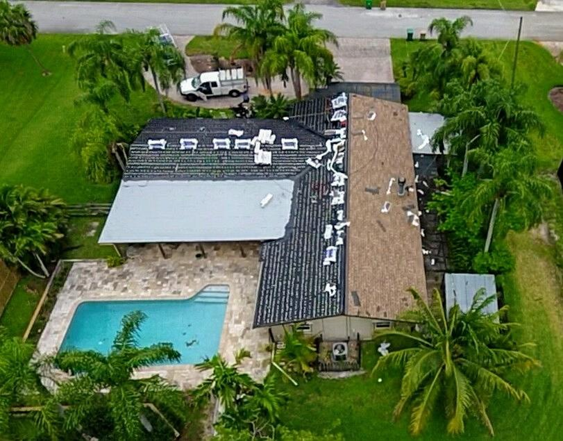 Davie, FL - Gaf Timberline hd Shakewood color shingle re-roof is being installed in Davie FL