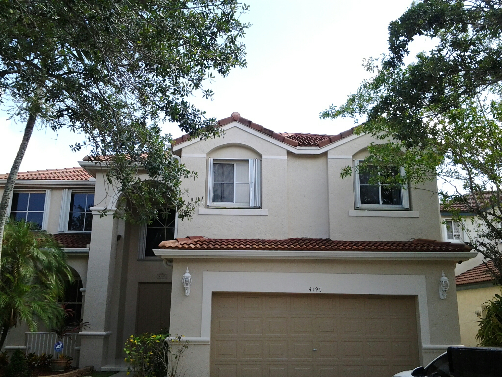 Weston, FL - Spot clean and roof acid  roof