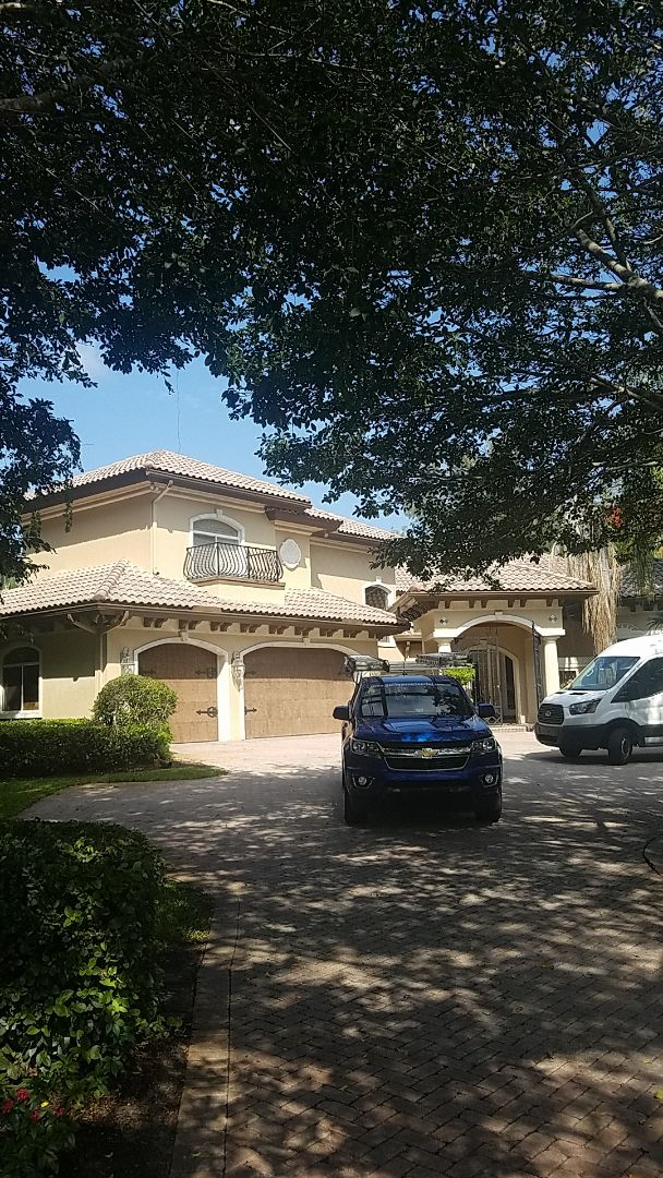 Boca Raton, FL - Eagle capistrano tiles roof replacement estimate by AJ from Earl Johnston Roofing Company