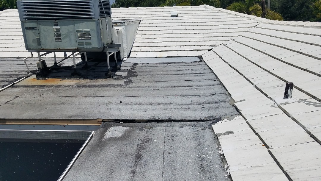 Hollywood, FL - Tile and flat re-roof estimate in Hollywood,FL