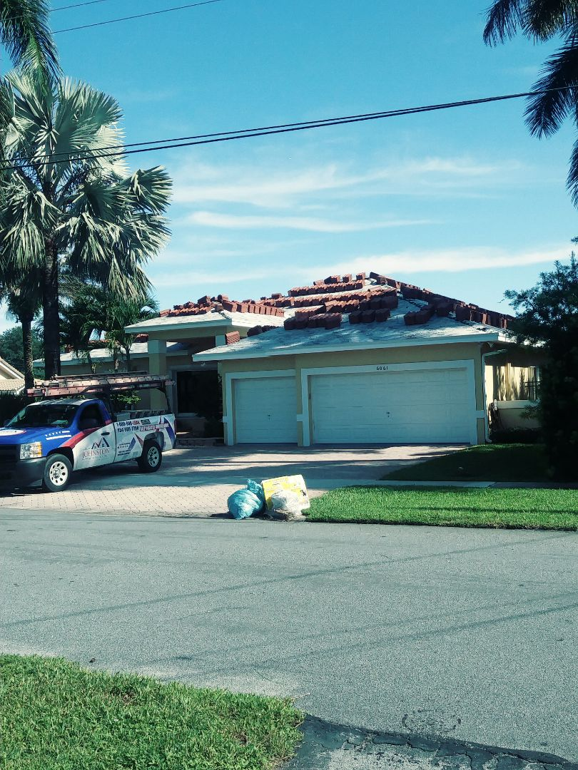 Plantation, FL - Roof tile loaded on roof ready to be installed by earl w Johnston roofing llc
