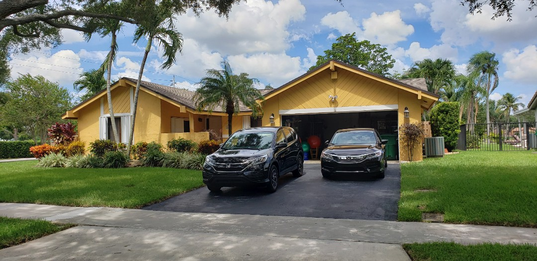 Shingle roof repair estimate in Cooper City, FL by Mike Wilde of Earl Johnston Roofing