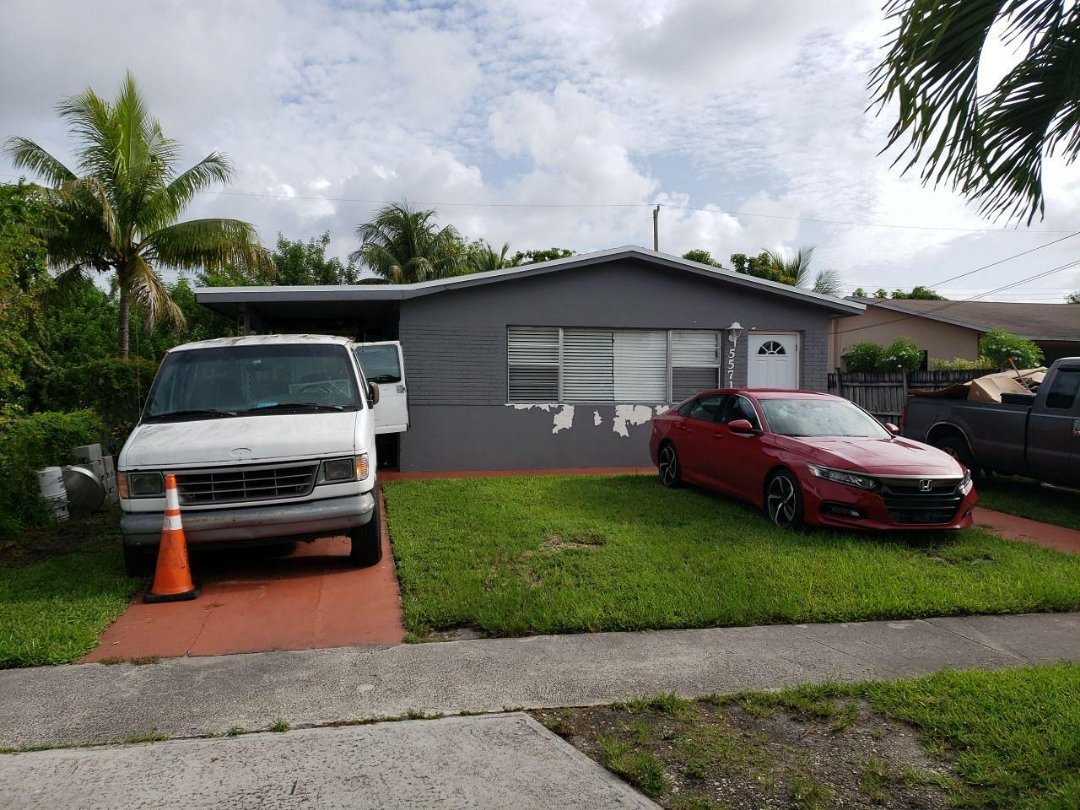 Hollywood, FL - Gaf Timberline shingle and flat re-roof estimate in Hollywood,FL by Mike Wilde of Earl Johnston Roofing