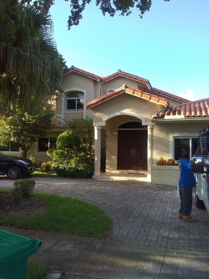 Miami, FL - Tile roof repair in the city of Miami Florida this repair is being done by Earl W Johnston roofing company Tony and Ron are you repair technicians