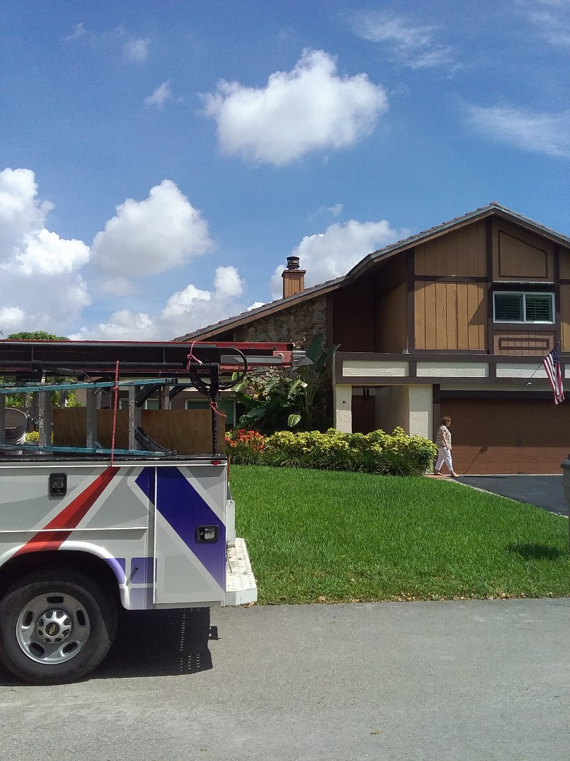 North Miami Beach, FL - Roof tile repair in the city of North Miami Beach Florida is repairs being done by Earl w Johnston roofing company Tony and Ron are you repair technicians